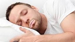 man wearing somnifix mouth strips